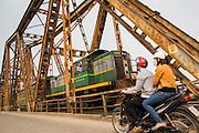 02 APRIL 2012 - HANOI, VIETNAM: The Hanoi to Hai Phong Express Train crosses the Red River on the Long Bien Bridge in Hanoi, the capital of Vietnam.    PHOTO BY JACK KURTZ