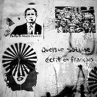 """Translation: """"TA-TE-TI DEATH FOR YOU"""" (L) """"A FEW STUPIDITIES WRITTEN IN FRENCH """"(R)<br /> <br /> Buenos Aires, Argentina March 2006<br /> Protest, resistance and memory:  The Stencil images in Buenos Aires. <br /> The stencil art takes the streets of the Argentinian capital. Urban artists bomb in silence the city with messages that combine political and social content, imagination and irony.<br /> Photo: Ezequiel Scagnetti"""