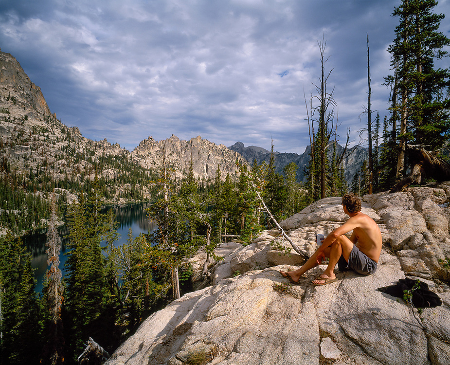 Pierre enjoys the morning view and stillness of Lower Baron Lake in the Sawtooth Mountains of Idaho. Licensing and Open Edition Prints. MR