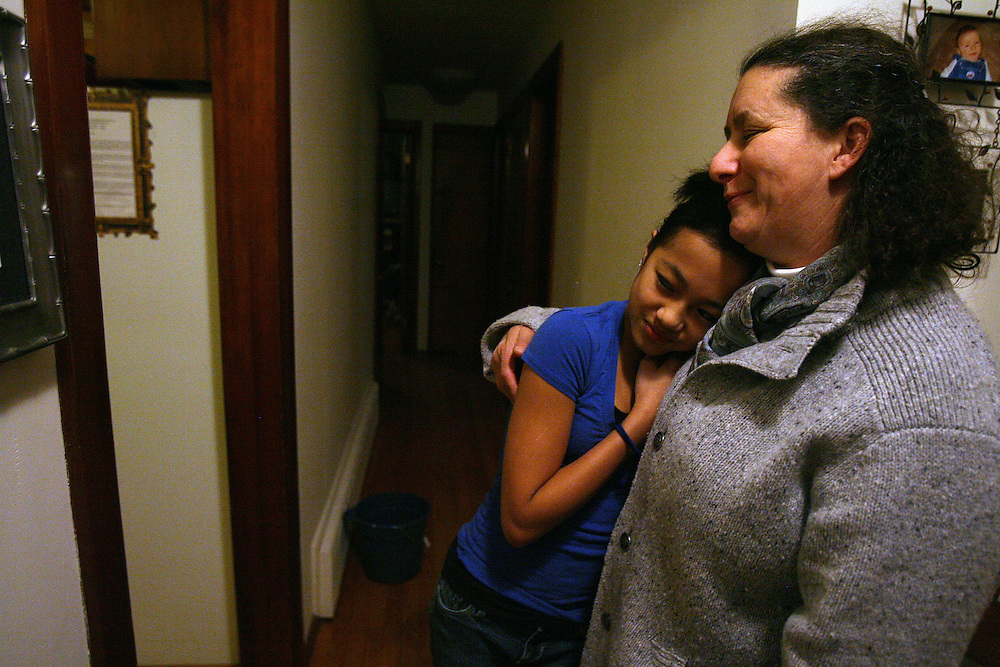2/10/2009 Northampton, MA-  Lani Dickinson, 14, and her mother Julie Bell share a moment at home.  Despite her disability, Lani trains hard as a ballerina and would like to someday be a professional dancer.