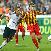 Besiktas's Filip HOLOSKO (L) and Alania Vladikavkaz's Anton GRIGORIEV (R) during their UEFA Europa League Play-Offs first leg match soccer match Besiktas between Alania Vladikavkaz at Inonu stadium in Istanbul Turkey on Thursday August 18, 2011. Photo by TURKPIX