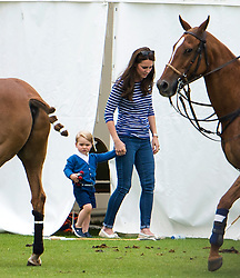© Licensed to London News Pictures. 14/06/2015. Prince George of Cambridge and his mother Catherine, Duchess of Cambridge. British Royals attend a charity Polo match in Tetbury,  Gloucestershire, UK. Photo credit: Ben Cawthra/LNP