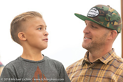 Custom bike builder Taber Nash with his son Reggie at the Flying Piston Builder Breakfast at the Buffalo Chip during the 78th annual Sturgis Motorcycle Rally. Sturgis, SD. USA. Sunday August 5, 2018. Photography ©2018 Michael Lichter.