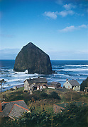 """CS03619. Haystack Rock, Cannon Beach. """"Oregon Coastline from Highway 101. March 1952"""" """"N. H. Adams. Carmel Ca."""""""