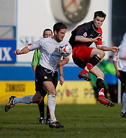 Photo: Leigh Quinnell.<br /> Luton Town v Southampton. Coca Cola Championship. 07/04/2007. Southamptons Danny Guthrie jumps with Lutons Chris Coyne.