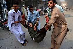 60539673  <br /> People transfer an injured man from the blast site in northwest Pakistan s Peshawar on Sept. 29, 2013. At least 29 were killed and 70 others injured as a blast hit Paksitan's northwest city of Peshawar on Sunday morning, said hospital sources, on Sunday Sept. 29, 2013. Picture by imago /  i-Images<br /> UK ONLY