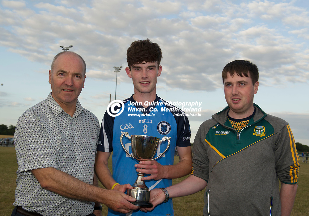 18-07-18. Simonstown Gaels v Dunshaughlin U-19 B Football Final at Dunganny.<br />Pat O'Reilly (Left), Pat O'Reilly Solicitors and Brian Kelly, Secretary Fe 18 presenting the Meath U-19 B Cup to Michael Gavin, Captain Simonstown Gaels.<br />Photo: John Quirke / www.quirke.ie<br />©John Quirke Photography, Unit 17, Blackcastle Shopping Cte. Navan. Co. Meath. 046-9079044 / 087-2579454.