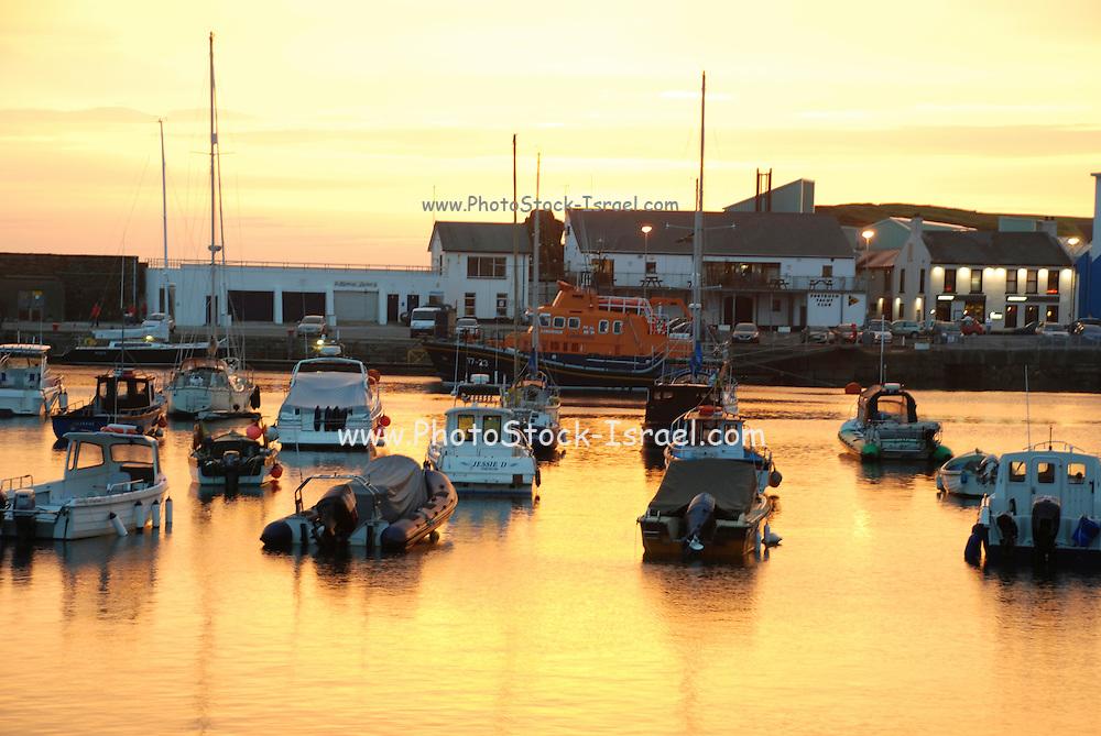 UK, Northern Ireland, County Antrim, Portrush The harbour at sunset