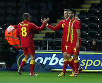 Pictured: Gareth Bale of Wales (C) with team mates Craig Bellamy (L) and Joseph (Joe) Ledley celebrating his opening goal. Wednesday 06 February 2013..Re: Vauxhall International Friendly, Wales v Austria at the Liberty Stadium, Swansea, south Wales.