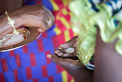3 November 2019, Monrovia, Liberia: Bread is distributed during Holy Communion as part of Sunday service at Saint Andrew Lutheran Parish in Monrovia. Part of the Lutheran Church in Liberia, the parish gathers some 220 members for prayer each week.