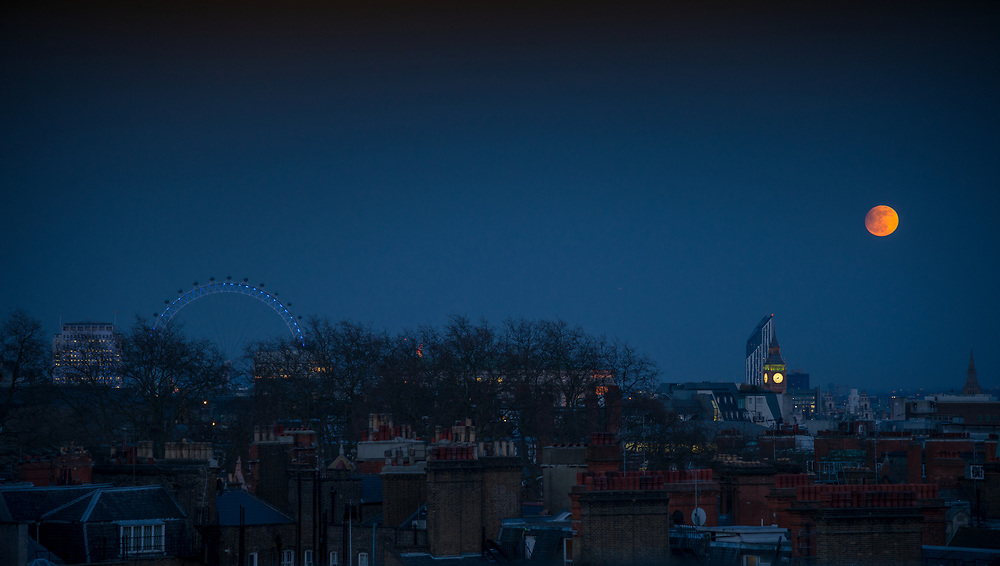 View of the London Skyline with a full moon, Big Ben and the Eye visible from Park Lane. Licensing and Open Edition Prints.
