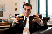 05 JAN 2012, BERLIN/GERMANY:<br /> Cem Oezdemir, B90/Gruene Bundesvorsitzender, waerhend einem Interview, in seinem Buero, Bundesgeschaeftsstelle Buendnis 90 / Die Gruenen<br /> IMAGE: 20120105-01-025<br /> KEYWORDS: Cem Özdemir, Büro
