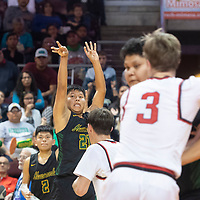 Newcomb Skyhawk Zachary John (21) takes a shot during their 2A boys NMAA State Basketball quarterfinal playoff game against Menaul Panthers at the Santa Ana Star Center in Rio Rancho Wednesday. The Skyhawks beat the Panthers 65-41 to advance to the semifinal round.