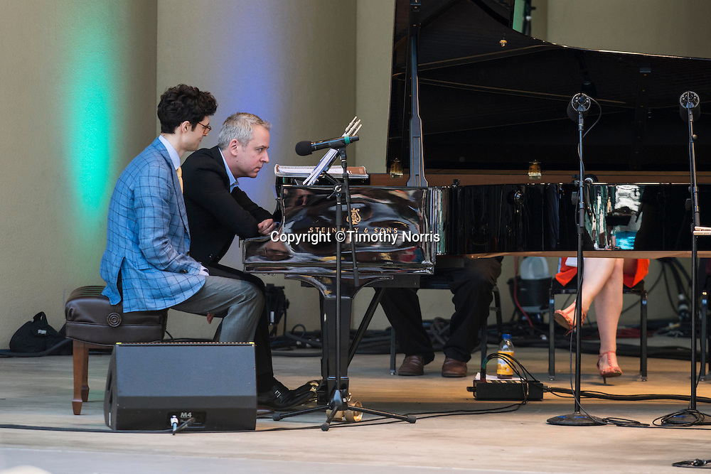 """Pianists Jeremy Denk and Timo Andres perform """"Canonade"""" a melange of musical canons devised by Jeremy Denk with music by Josquin,  Mozart, Schumann, Kurtág, P.D.Q. Bach, Isham, Purcell, Stanchinsky, Beethoven, Haydn, Uri Caine and J.S. Bach at the 68th Ojai Music Festival at Libbey Bowl on June 15, 2014 in Ojai, California."""