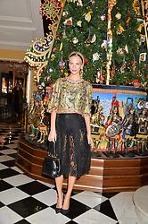 POPPY DELEVINGNE at the Claridge's Christmas Tree By Dolce & Gabbana Launch Party held at Claridge's, Brook Street, London on 26th November 2013.