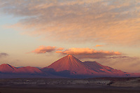 Licancabur is a highly symmetrical stratovolcano on the southernmost part of the border between Chile and Bolivia. It is located just southwest of Laguna Verde in Bolivia. The volcano dominates the landscape of the Salar de Atacama area. The lower two thirds of the northeastern slope of the volcano belong to Bolivia, 5,400 m (17,717 ft) from the foot at 4,360 m (14,304 ft), while the rest and biggest part, including the higher third of the northeastern slope, the crater and summit, belong to Chile