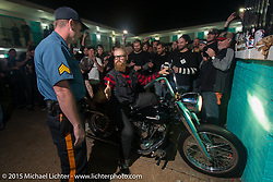 Negotiating a burn-out with a cop at the Harley-Davidson sponsored Friday evening party in the hotel parking lot before the Race of Gentlemen. Wildwood, NJ, USA. October 9, 2015.  Photography ©2015 Michael Lichter.