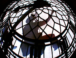 Abseiler's clean one of the faces of the Big Ben clock on the tower of the Houses of Parliament in London.