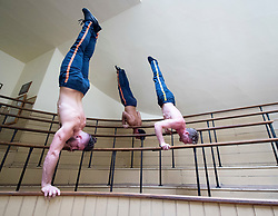 """Head First Acrobats experiment at the Old Operating Theatre Museum ahead of their performances of Elixir at the Underbelly Festival.<br /> <br /> Thomas Gorham,  Cal Harris, Rowan Thomas <br /> <br /> Head First Acrobats ()who won the Best Circus and Physical Theatre Award show off their incredible circus skills at the Old Operating Theatre Museum, London, Great Britain <br /> 7th June 2018 <br /> <br /> Their show """"Elixir"""" is part of the Underbelly Festival from Tuesday 12th June. <br /> <br /> When three gleefully inept scientists attempt to produce the Elixir of Life, chaos erupts in the laboratory. Tumbling on the spinning Cyr wheel, handstanding on tottering ladders, balancing on their heads on a swinging trapeze, the Head First Acrobats' bring their signature mix of comedy caper and incredible acrobatic talent to the Southbank.<br />  <br /> Photograph by Elliott Franks"""