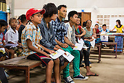 20 MAY 2013 - MAE KASA, TAK, THAILAND: Burmese patients in the outpatient waiting room at the SMRU clinic in Mae Kasa, Thailand. The clinic is less than 50 meters from the Thai-Burma border and sees only Burmese patients. Thais go to Thai government hospitals. Health professionals are seeing increasing evidence of malaria resistant to artemisinin coming out of the jungles of Southeast Asia. Artemisinin has been the first choice for battling malaria in Southeast Asia for 20 years. In recent years though,  health care workers in Cambodia and Myanmar (Burma) are seeing signs that the malaria parasite is becoming resistant to artemisinin. Scientists who study malaria are concerned that history could repeat itself because chloroquine, an effective malaria treatment until the 1990s, first lost its effectiveness in Cambodia and Burma before spreading to Africa, which led to a spike in deaths there. Doctors at the Shaklo Malaria Research Unit (SMRU), which studies malaria along the Thai Burma border, are worried that artemisinin resistance is growing at a rapid pace. Dr. Aung Pyae Phyo, a Burmese physician at a SMRU clinic just a few meters from the Burmese border, said that in 2009, 90 percent of patients were cured with artemisinin, but in 2010, it dropped to about 70 percent and is now between 55 and 60 percent. He said the concern is that as it becomes more difficult to clear the parasite from a patient, progress that has been made in combating malaria will be lost and the disease could make a comeback in Southeast Asia.    PHOTO BY JACK KURTZ