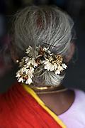 Flowers in a woman's hair in the Tamaraikulum Elders's Village, Cuddalore, Tamil Nadu, India