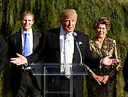 Oct. 04, 2011 - Charlottesville, VA. USA; Donald Trump speaks in front of Eric Trump, left, and Patricia Kluge, right, during a press conference announcing the grand opening of Trump Vineyard Estates Tuesday in Charlottesville, Va. Trump purchased the foreclosed vineyard, previously owner by Patricia Kluge, at auction earlier this year. The 2,000 acre Trump Vineyard estate is also the home to Trump Winery, helmed by Donald's son Eric Trump.  (Credit Image: © Andrew Shurtleff)