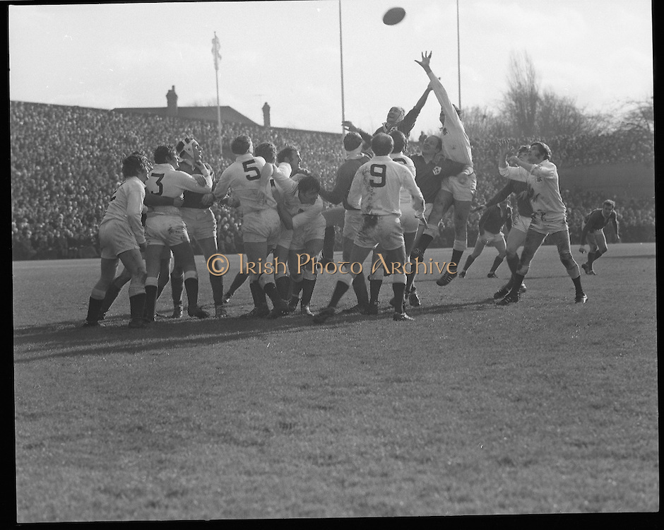 Ireland Vs England at Lansdowne Rd..1971..13.02.1971..02.13.1971..13th February 1971..In the Five Nations Championship, Ireland took on England at Lansdowne Road,Dublin. The final score in the game was Ireland 6,England 9..Bob Hiller,the England fullback,scored all his teams points with three penalties..Ireland replied with two tries from Grant and Duggan..In the championship,Wales won the Triple Crown and completed the Grand Slam when they defeated France in their final game of the season..Pictured, the England team go highest in attempting to knock the ball back to scrumhalf,Page.