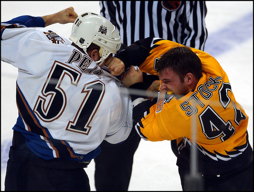 (01/05/02 Boston, MA)  Boston Bruins vs Washington Capitals. Bruins #42 P. J. Stock lands a punch on #51 Stephen Peat in a second period brawl.  (010502bruins-Staff Photo by Michael Seamans. Saved in Photo Sun.)