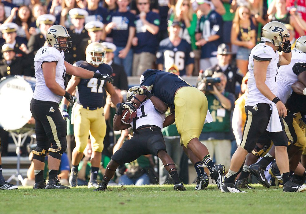 September 08, 2012:  Notre Dame defensive end Stephon Tuitt (7) tackles Purdue running back Akeem Hunt (11) during NCAA Football game action between the Notre Dame Fighting Irish and the Purdue Boilermakers at Notre Dame Stadium in South Bend, Indiana.  Notre Dame defeated Purdue 20-17.