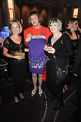 Left to right, MARIELLA FROSTRUP, GRAYSON PERRY and his wife PHILIPPA FAIRCLOUGH at the Liberatum Dinner hosted by Ella Krasner and Pablo Ganguli in honour of Sir V S Naipaul at The Landau at The Langham, Portland Place, London on 23rd November 2010.