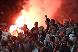 A flare is set off in amongst the Cologne fans - Mandatory by-line: Patrick Khachfe/JMP - 14/09/2017 - FOOTBALL - Emirates Stadium - London, England - Arsenal v Cologne - UEFA Europa League Group stage