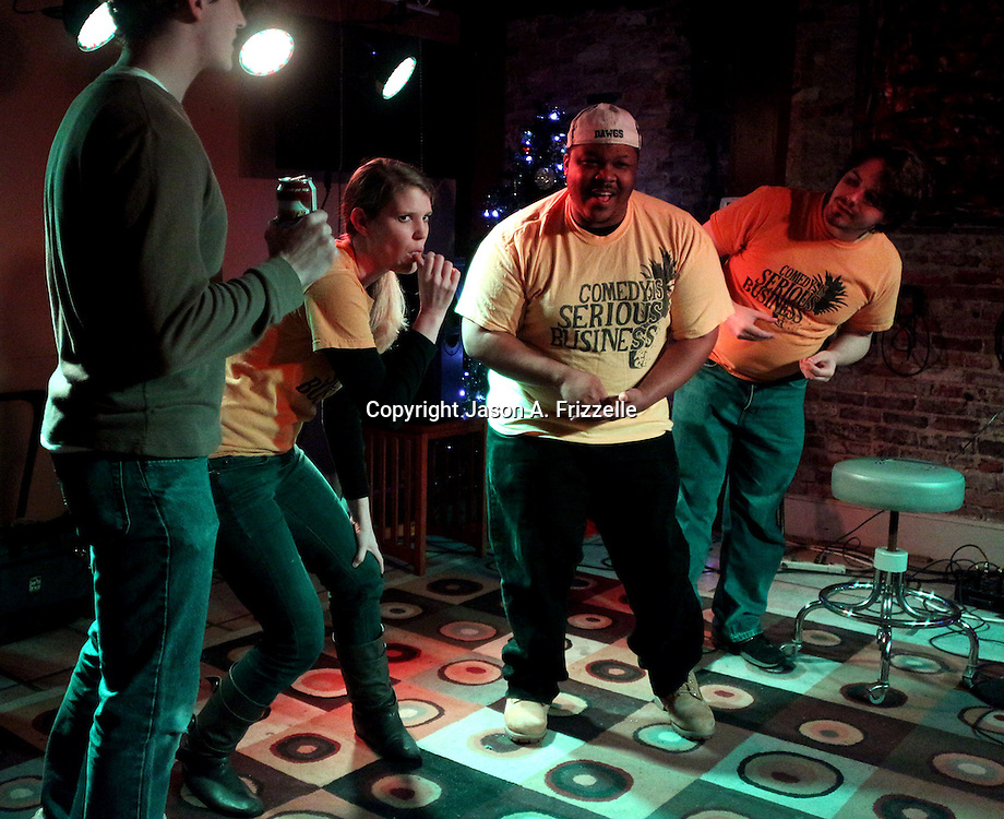 Zach Pappas, left Jordan Mullaney, center, Brick Jackson, right-center and Brett J. Young perform during Pineapple Shaped Lamps' premiere party for Sketch 22, a show that airs on the Cape Fear CW. (Jason A. Frizzelle)