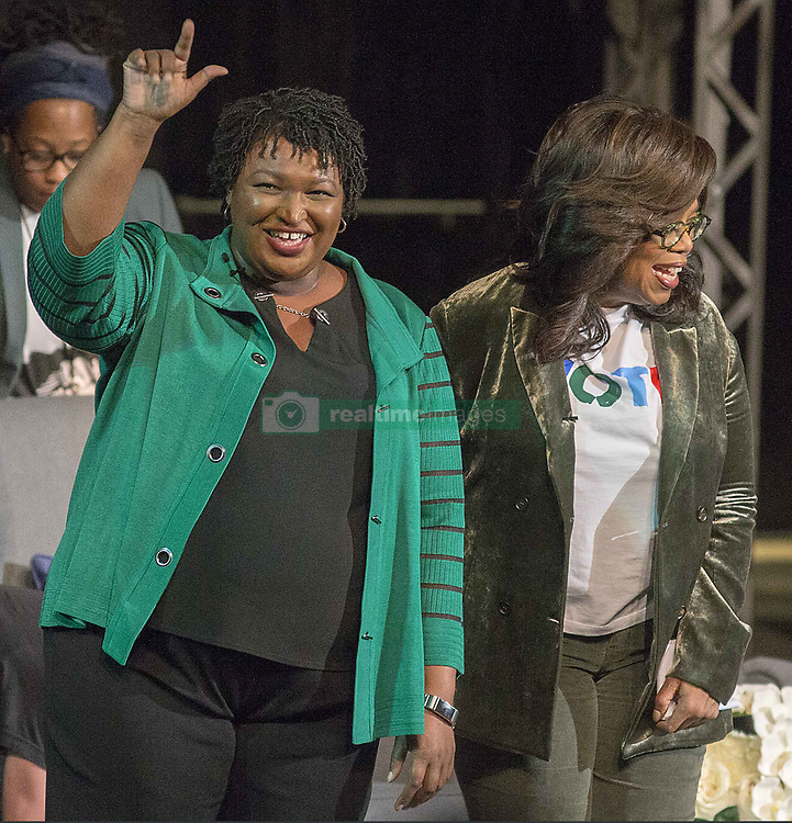 November 1, 2018 - Marietta, Georgia, U.S. - OPRAH WINFREY and Georgia gubernatorial candidate STACEY ABRAMS greet a crowd gathered for a town hall conversation on Thursday, at the Cobb Civic Center's Jennie T. Anderson Theatre. Winfrey visited Georgia on Thursday to canvass neighborhoods in metro Atlanta and show her support for Abrams. (Credit Image: © Alyssa Pointer/Atlanta Journal-Constitution/TNS via ZUMA Wire)