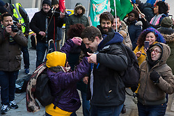 London, UK. 22nd January, 2019. Supporters of receptionists, security guards and cleaners at the Ministry of Justice (MoJ) represented by the United Voices of the World (UVW) trade union dance on the picket line after beginning a strike for the London Living Wage of £10.55 per hour and parity of sick pay and annual leave allowance with civil servants. The strike is being coordinated with support staff at the Department for Business, Energy and Industrial Strategy (BEIS) from the Public and Commercial Services (PCS) union.