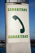 Samaritans Freephone sign with arrow,  Orwell Bridge, near Ipswich, Suffolk, England