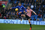 Joe Bennett of Cardiff city (l) gets to the ball ahead of Billy Jones of Sunderland. EFL Skybet championship match, Cardiff city v Sunderland at the Cardiff city stadium in Cardiff, South Wales on Saturday 13th January 2018.<br /> pic by Andrew Orchard, Andrew Orchard sports photography.