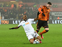Football - 2017 / 2018 FA Cup - Third Round, Replay: Swansea City vs. Wolverhampton Wanderers<br /> <br /> Matt Doherty Wolverhampton Wanderers tackled by Jordan Ayew of Swansea City, at The Liberty Stadium.<br /> <br /> COLORSPORT/WINSTON BYNORTH