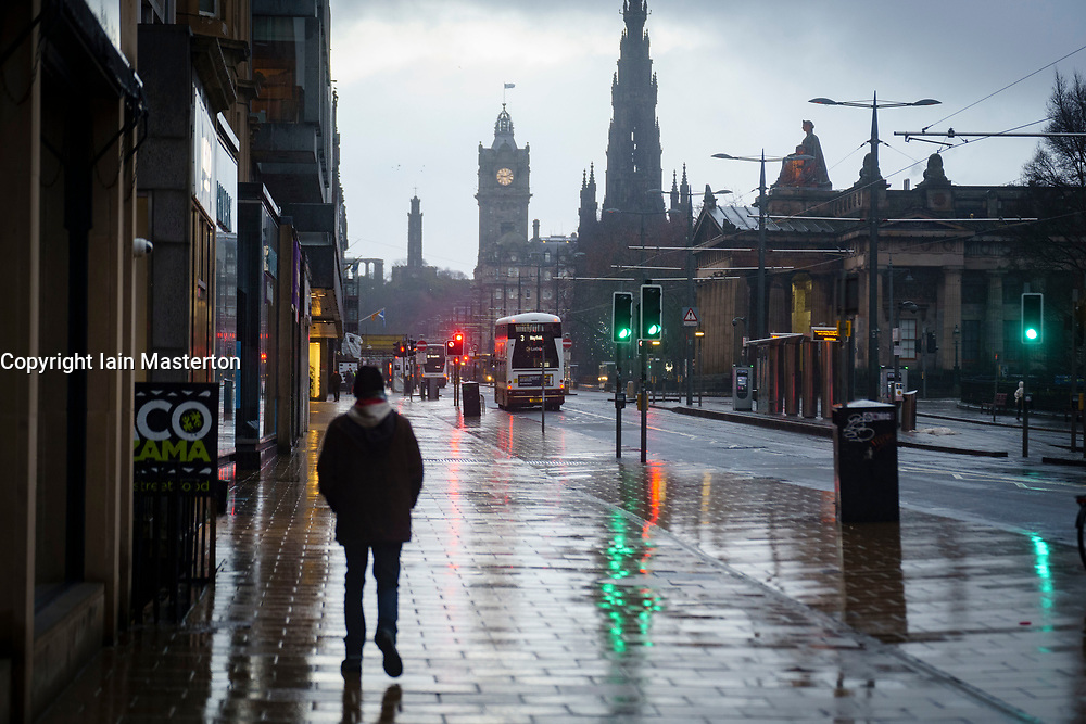 Edinburgh, Scotland, UK. 5 January 2020. Views of a virtually deserted Edinburgh City Centre as Scotland wakes up to the first day of a new strict national lockdown announced by Scottish Government to contain new upsurge in Covid-19 infections. Pic; Princes Street is very quiet with little traffic or people.  Iain Masterton/Alamy Live News