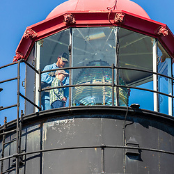 A man and his son visit the West Quoddy Head Lighthouse in Lubec, Maine. Easternmost point in the United States.