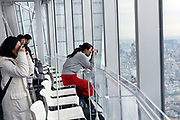 people photographing the view from Tokyo City View deck in the Mori Tower Roppongi