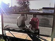 18 NOVEMBER 2011 - PHOENIX, AZ: People at a bus stop on Thomas Rd in Phoenix, AZ.  PHOTO BY JACK KURTZ