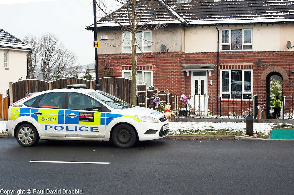 Police and a small number of  Floral Tributes outside the house on Beck Road where a Three Year old girl was taken from to Sheffield Childrens Hosptial on Friday (8th feb). The girl later died around 12:20am Saturday morning (9 Feb).A 30-year-old man charged with murder of three-year-old girl from Beck Road Shiregreen, Sheffield..11 February 2013.Image © Paul David Drabble