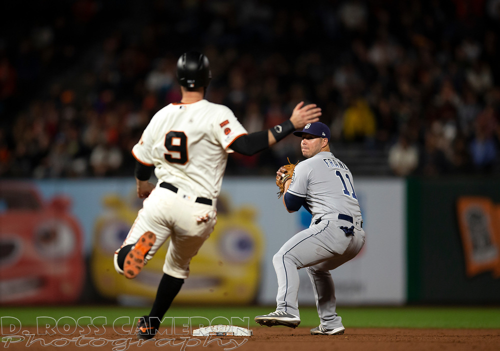 San Diego Padres second baseman Ty France (11) winds up to throw over San Francisco Giants baserunner Brandon Belt (9) to complete a double play during the eighth inning of a baseball game, Thursday, Aug. 29, 2019, in San Francisco. The Padres won 5-3. (AP Photo/D. Ross Cameron)