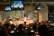 Martin Yan, chef, at Copia: The American Center for Food, Wine, and the Arts. Martin Yan gave a cooking demonstration of 'fire cracker chicken' at Copia's Meyer Food Forum cooking amphitheater. Napa, California. Napa Valley.