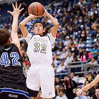 021513       Cable Hoover<br /> <br /> Chinle Wildcat Jalen Claw (32) shoots over the Fountain Hills Falcons defense during the Arizona State Basketball Tournament at the NAU Walkup Skydome in Flagstaff Friday.