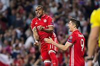 Douglas Costa and Robert Lewandowski of FC Bayern Munchen  celebrates after scoring a goal during the match of Champions League between Real Madrid and FC Bayern Munchen at Santiago Bernabeu Stadium  in Madrid, Spain. April 18, 2017. (ALTERPHOTOS)