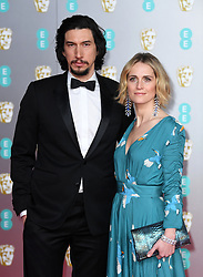 Adam Driver and Joanne Tucker attending the 73rd British Academy Film Awards held at the Royal Albert Hall, London. Photo credit should read: Doug Peters/EMPICS Entertainment