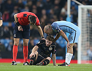 James Forrest of Celtic goes down injured during the Champions League Group C match at the Etihad Stadium, Manchester. Picture date: December 6th, 2016. Pic Simon Bellis/Sportimage