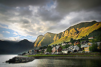Photo of the sun setting over the stunning landscape of Aurland, Norway.
