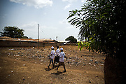 Health workers and volunteers walk through the town of Salaga, northern Ghana during a national polio immunization exercise in Salaga, northern Ghana on Thursday March 26, 2009..